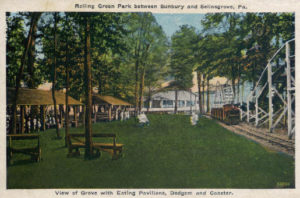 View of Grove with Eating Pavilions, Dodgem and Coaster at Rolling Green Park